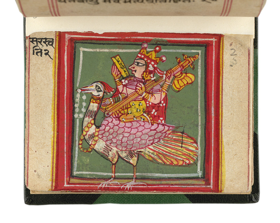 Sri Saraswati, Goddess of learning and music, playing an aveena as she rides a peacock